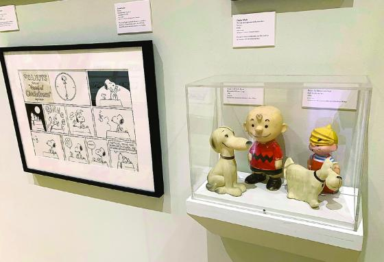 The exhibit includes vinyl toys of Charlie Brown and Snoopy and Dennis the Menace and Ruff. (AP/Andrew Welsh-Huggins)