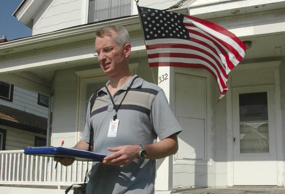 Timothy Culp-Northwood, a census enumerator, does follow-up visits to homes in Racine, Wisconsin. He was assigned to try to get people who did not mail in census forms to participate in the census. (AP)