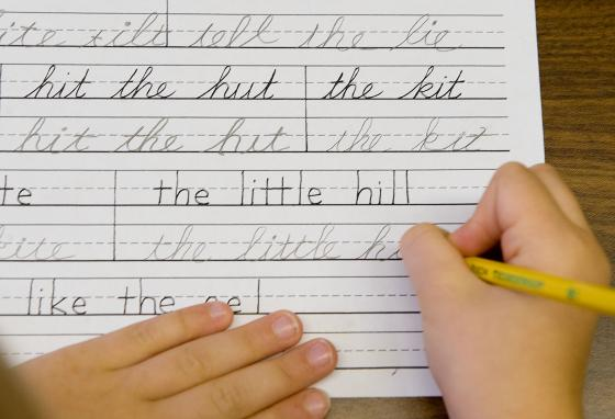 Students practice both cursive and print handwriting skills at the Mountaineer Montessori School in Charleston, West Virginia. Writing in cursive helps us remember information. (AP/Bob Bird)