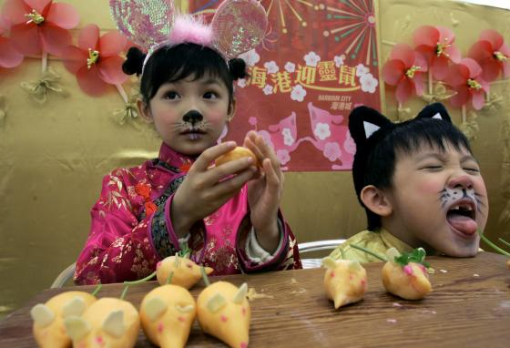 Children learn how to make radish dim sum in the shape of mice to celebrate the Chinese Lunar Year. (AP/Kin Cheung)