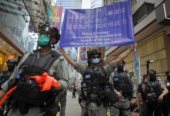 Police display a banner warning people not to protest. Hong Kongers have had the right to express beliefs freely until now. (AP)