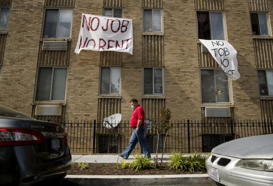 "Signs that read ""No Job No Rent"" hang from an apartment building in northwest Washington state. Many renters lost jobs due to the pandemic. They struggle to pay rent. (AP)"