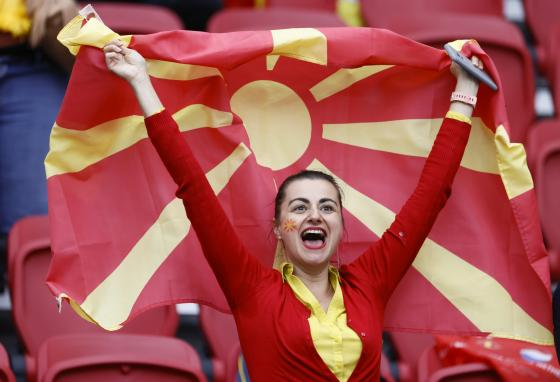 A North Macedonia soccer team supporter holds a national flag at the Euro 2020 soccer championship match between North Macedonia and the Netherlands on June 21, 2021. (Koen van Weel/Pool via AP)