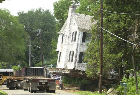 A 1929 four-bedroom brick Colonial house is slowly moved onto its lot in suburban Chatham, New Jersey. (AP/Mike Derer)