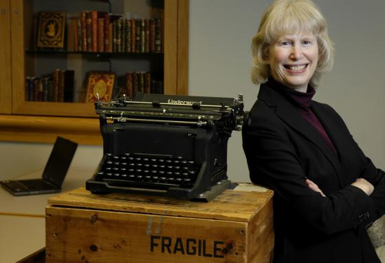 Archivist Elaine Engst poses with a typewriter used by E. B. White. (AP/Kevin Rivoli)