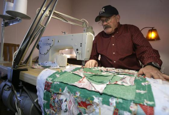 Frank Halden auctions off his quilts to help fund cancer research. (AP/Toby Talbot)