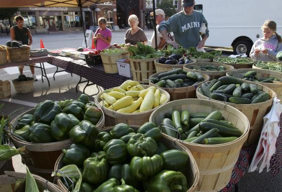 Shoppers look at fresh produce at a farmers market in Concord, New Hampshire. (AP Photo/Jim Cole)