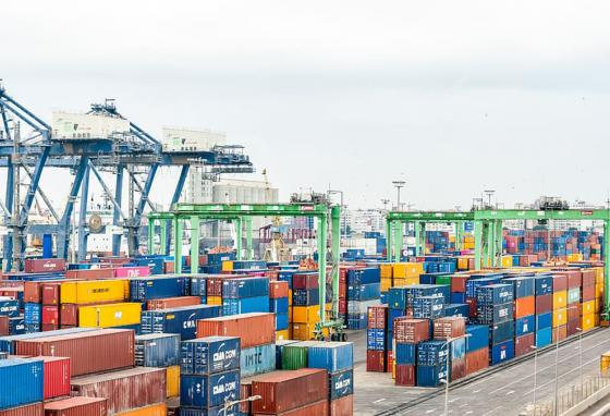 At loading docks, cargo ships get filled up with goods bound for other countries.