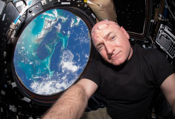Scott Kelly takes a photo of himself inside the Cupola, a special part of the International Space Station which provides viewing of the Earth and the station. (AP)