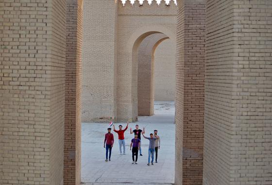 People celebrate at the ruins of ancient Babylon, now named as a World Heritage Site. (AP)
