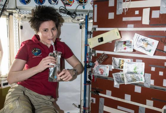 Samantha Cristoforetti takes a sip aboard the International Space Station. Droplets and crumbs can float into equipment if astronauts aren't careful. (NASA)