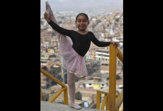 Keith Chavez shows her flexibility in the Chorrillos neighborhood of Lima, Peru. (AP)