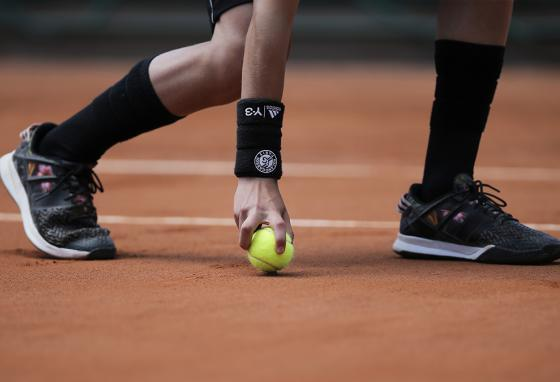 A ball boy rolls a ball at the French Open tennis tournament in Paris, France. (AP)