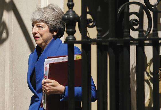 Previous prime minister Theresa May leaves Number 10. (AP)