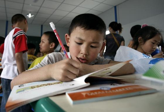 Children do desk work in China's Sichuan province. (AP)
