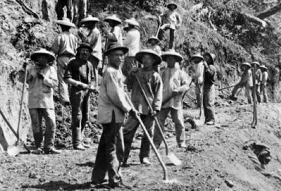 Chinese workers pause for a picture during their hard labor clearing a railroad bed. (LOC)