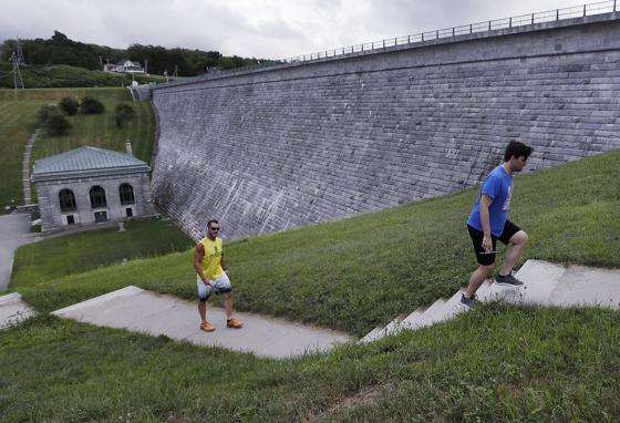 Men climb stairs while working out at the Wachusett Reservoir Dam in Clinton, Massachusetts. The dam is considered highly hazardous. (AP)