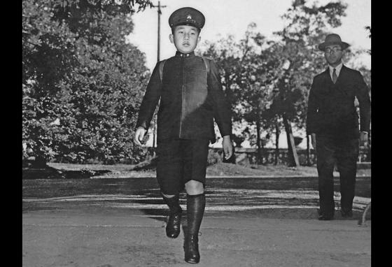 Crown Prince Akihito is seen in 1945 at age 11, on his way to school in Tokyo, Japan. (AP)