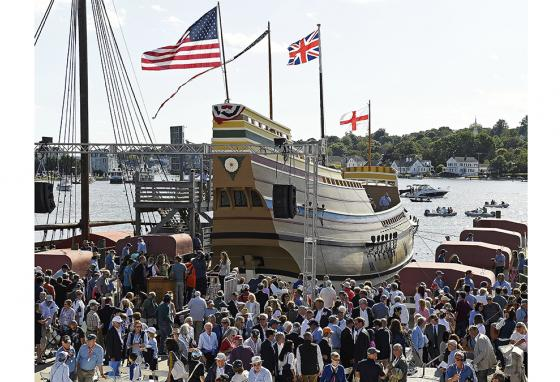A crowd waits to watch the Mayflower II slide from dry dock into the river. (AP)
