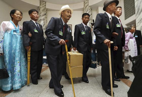 North Koreans stand to meet their South Korean family members at the Separated Family Reunion Meeting. (AP)