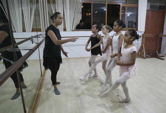 Maria del Carmen Silva, a former professional dancer, instructs ballet students, (from left) Ariana, Ivana, Claudia, and Dana. (AP)