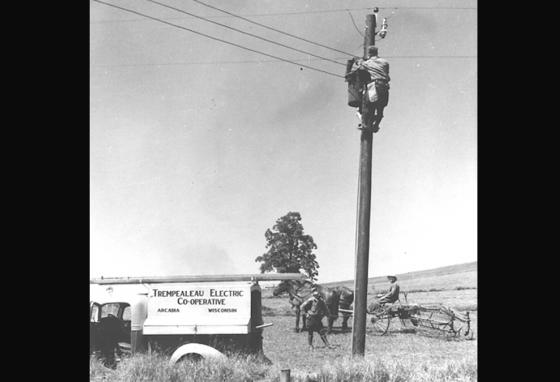 Farmers watch as a power line is strung in Missouri in 1942. (LOC)