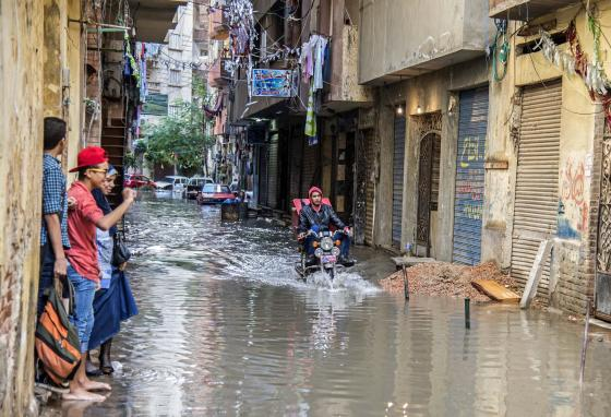Streets are flooded in Egypt's coastal city of Alexandria. Rising sea levels threaten to swamp poorer neighborhoods and archaeological sites there. (AP)