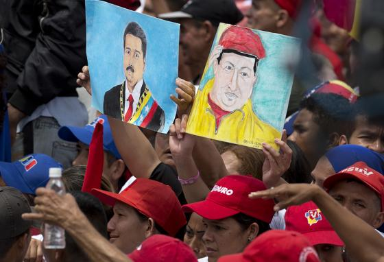 Some people still support socialist President Nicolas Maduro (left drawing), in power since the death of President Hugo Chavez (right). (AP)