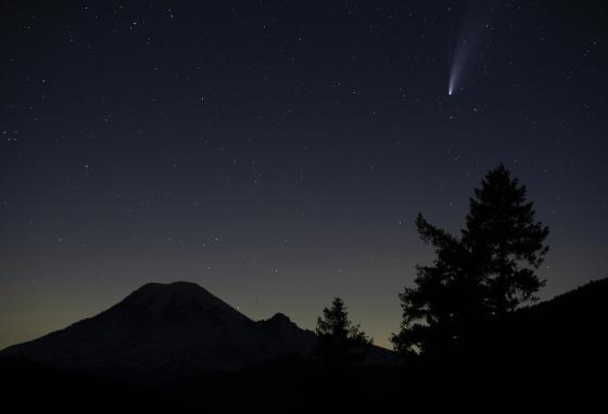 There's a lot going on in the universe. Much of that activity we can't see! This picture shows the comet Neowise above Mount Rainier in Washington state on July 18, 2020. (AP/Ted S. Warren)