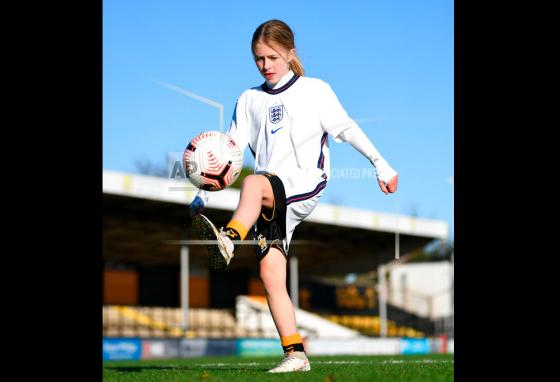 Imogen Papworth-Heidel completes her 7.1 million keepy uppies at the Abbey Stadium in Cambridge, England. (Joe Giddens/PA Wire/AP)
