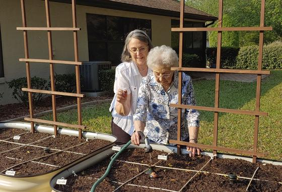 People of all ages can garden! Brenda Flowers (left) and 96-year-old Lorraine Tyree water their plants in Crystal River, Florida. (AP)