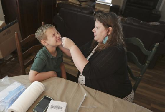 Hang tight! The family is doing testing twice each month to help answer questions about the coronavirus. (AP)