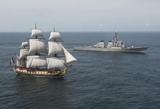 The French tall ship Hermione on the left is a replica of the one that brought Lafayette to America in 1780. (Petty Officer 1st Class Michael Sandberg/U.S. Navy via AP)