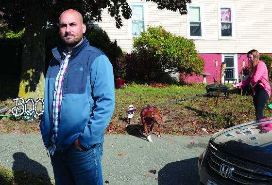 Shad Elia poses outside one of his properties as tenant Krystal Dingler walks her dog. Mr. Elia says hard-hit tenants are falling behind on their payments. He wonders how much longer his lenders will cut him slack. (AP)