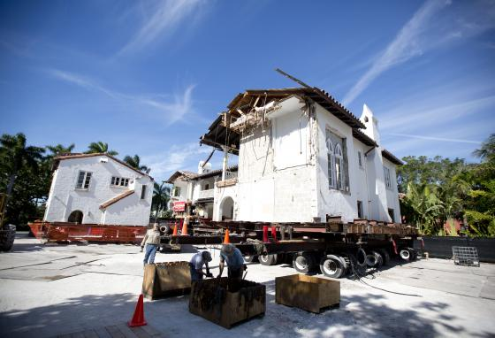 Workers move a section of a 1924 home in Miami Beach, Florida. Using giant remote controlled dollies, it took about two hours to move a section of the building 120 feet. (AP/J Pat Carter)