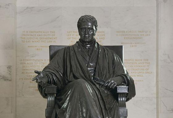 A statue of Chief Justice John Marshall sits in the lower level of the Supreme Court. (SCOTUS)