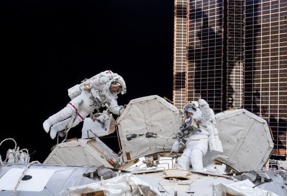 Bob Behnken (left) and Chris Cassidy give a thumbs up during a spacewalk on July 21, 2020. They are working on the ISS. (NASA)