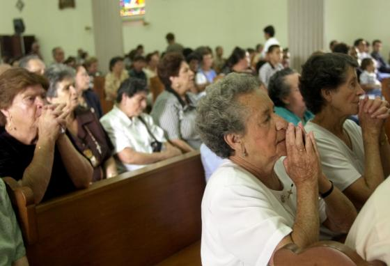 People pray at the Central Cathedral Heredia in Costa Rica. Costa Ricans tend to be polychronic. (AP/Kent Gilbert)
