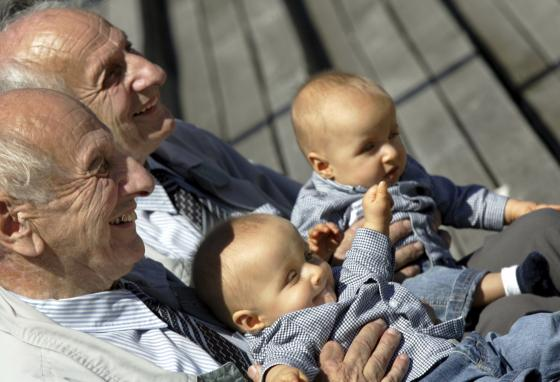 Identical twins Alf, front, and Sven Fehnhanhn pose with seven-month-old Luis Carl, front, and Albert Frank Millgramm during a twins' meeting in Berlin, Germany. (AP/Jockel Finck)