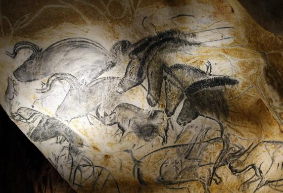 Cave drawings of animal figures, including a rhino, are seen in the life-sized replica of Grotte Chauvet in southern France. (AP/Claude Paris)