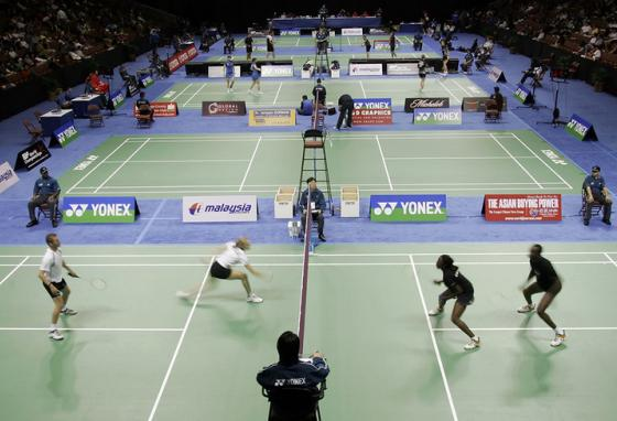 Played on a small court, badminton requires super-quick reflexes. (AP)