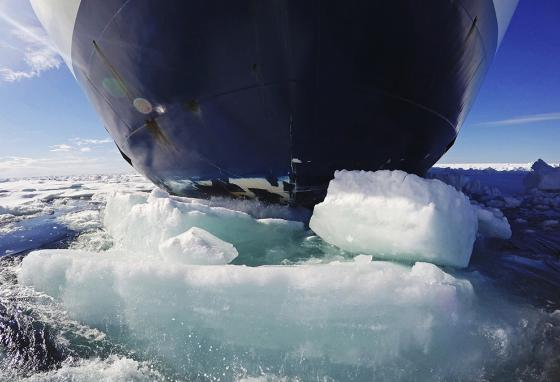 Icebreakers are required to smash through the ice to sail through the Arctic. If more ice melts, boats of all kinds will have easier sailing. (AP)