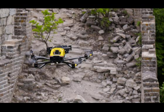 An Intel Falcon 8+ drone hovers above a deteriorating part of the Great Wall of China. (Intel)