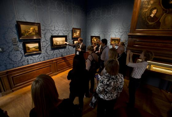 Visitors listen to a guide after the museum was renovated in 2014. (AP)