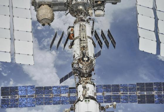 The International Space Station floats above Earth on October 4, 2018. Twenty years after the first crew arrived, the space station has hosted 241 visitors. (NASA/Roscosmos via AP)