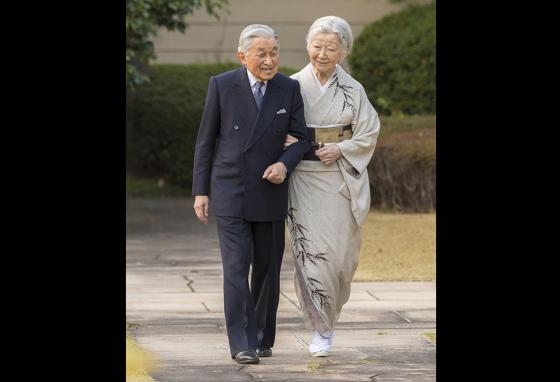 Emperor Akihito takes a walk with his wife, Empress Michiko, through the garden of the Imperial Palace. (AP)