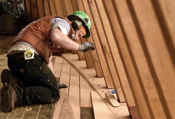 Shipwright Greg See fits a deck plank for the main deck of the Mayflower II at the H.B. duPont Preservation Shipyard. (AP)