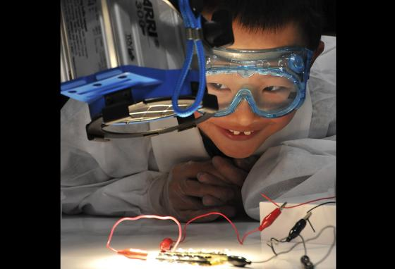 Safety glasses are used in some sports and kinds of work. Goggles are needed in other situations, like the science project this boy is working on. (AP)