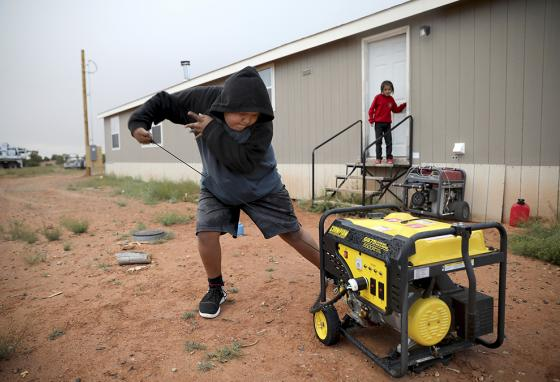 Before his home was connected to power lines, Jayden had to start up a generator, which was used sparingly because of the cost of fuel. (AP)
