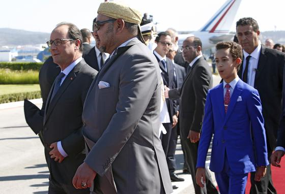 Morocco's Crown Prince Moulay Hassan (blue suit) in Tangiers, with his father King Mohammed VI (AP)